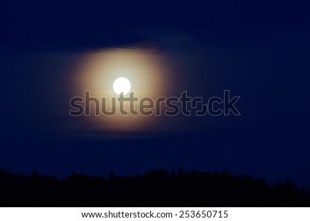 Shining moon in the haze - stock photo