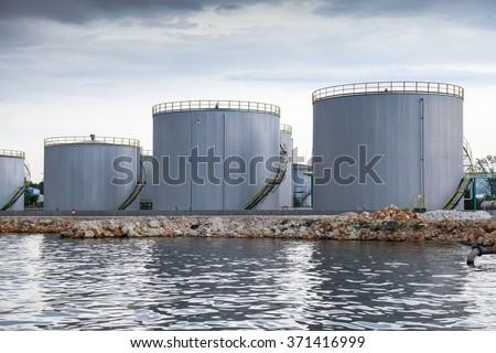 Shining oil tanks on Black sea coast in Varna port, Bulgaria - stock photo