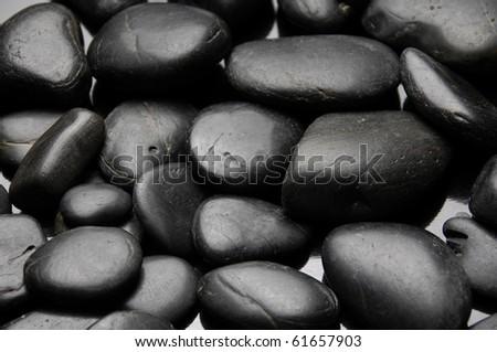 Shining smooth natural black stones - stock photo