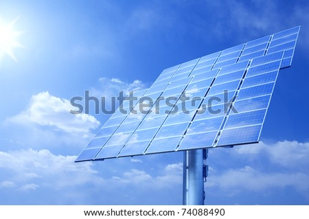 shining sun and solar panels - stock photo