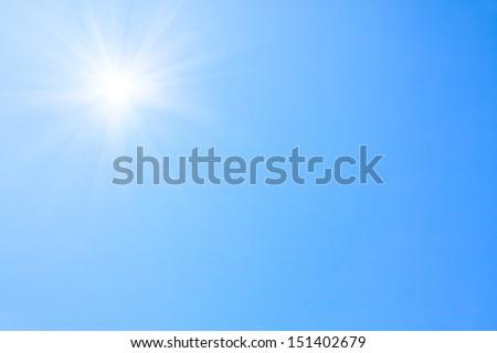 Shining sun at clear blue sky. - stock photo