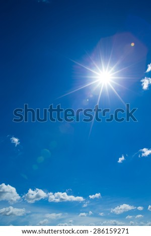 Shining sun at clear blue sky - stock photo