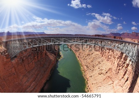 Shining sun on the bridge over the Colorado River - stock photo