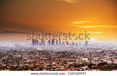 shining sun over Los Angeles at sunset, California