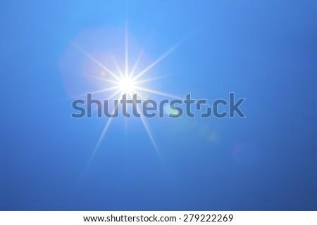 Shining sun with blue sky  - stock photo