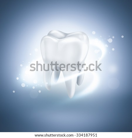 shining white tooth on light blue background - stock photo