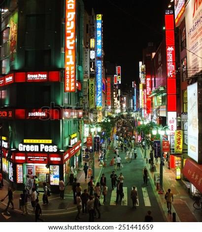 SHINJUKU, JAPAN - JULY 19 : SHINJUKU district taken July 19, 2008 in Tokyo. Most popular entertainment district and nightlife zone of Tokyo - stock photo