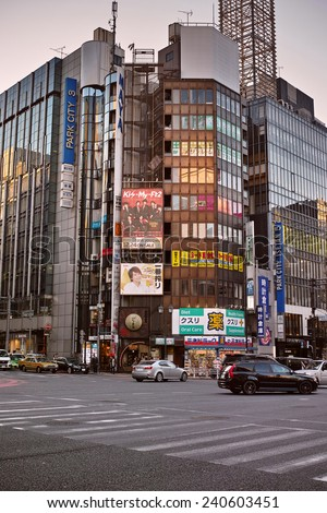 SHINJUKU, TOKYO - DECEMBER 27, 2014: Commercial building with many billboards in Shinjuku, the biggest night life district in Japan. - stock photo