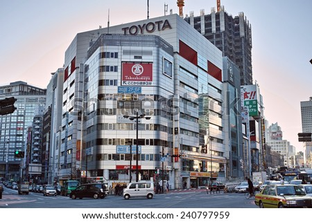 SHINJUKU, TOKYO - DECEMBER 27, 2014: Commercial building with many billboards in Shinjuku, the biggest night life district in Japan.