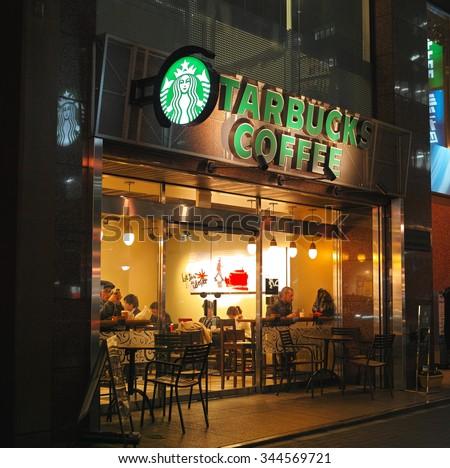 SHINJUKU, TOKYO - DECEMBER 9, 2014: Starbucks Coffee shop in Shinjuku 3 Chome area. Around 1,000 branches in Japan. - stock photo