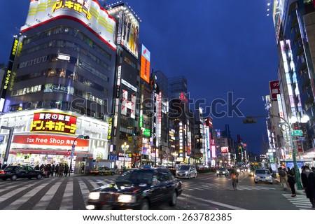 SHINJUKU, TOKYO - FEB 13 : Street life in Shinjuku on Feb 13,2015. Shinjuku is a special ward located in Tokyo Metropolis, Japan. It is a major commercial and administrative center. - stock photo