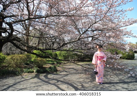 Shinjuku, Tokyo, Japan - Mar. 25, 2016: Young woman is flowering.