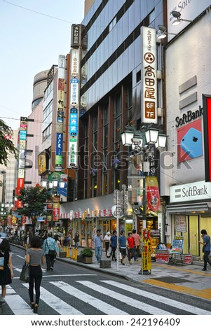 SHINJUKU, TOKYO - MAY 31, 2014: Commercial building with many billboards in Shinjuku, the biggest business, shopping, restaurants and night life district in Japan. - stock photo