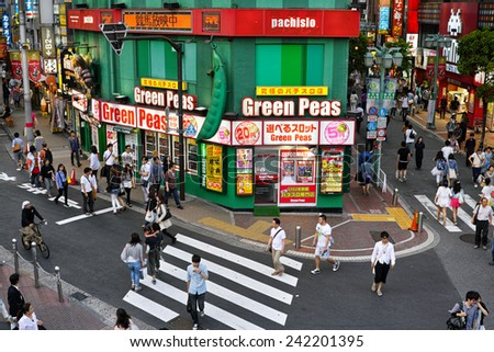 SHINJUKU, TOKYO - MAY 31, 2014: Green Peas (name of the shop) Pachinko gambling parlor in Southern part of Shinjuku. Pachinko is the most popular gamble in Japan.