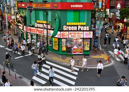 SHINJUKU, TOKYO - MAY 31, 2014: Green Peas (name of the shop) Pachinko gambling parlor in Southern part of Shinjuku. Pachinko is the most popular gamble in Japan. - stock photo