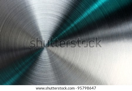 Shiny abstract metallic texture with blue rays pattern. - stock photo