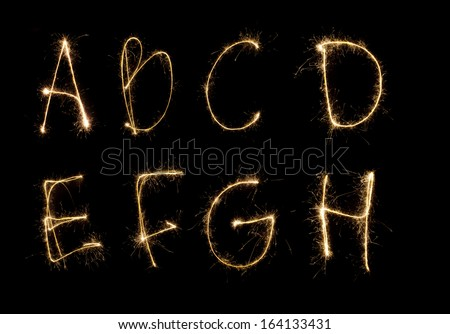 Shiny alphabet isolated on black. (see other letters in my portfolio) - stock photo