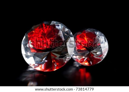 Shiny and bright two rubies on black background