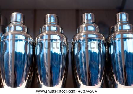 shiny and chic cocktail shakers as background - stock photo