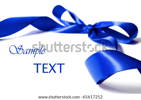 Shiny blue satin ribbon on white background with copy space. Macro with extremely shallow dof. - stock photo