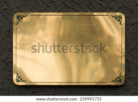 Shiny brass yellow metal sign plate texture isolated with clipping path - stock photo