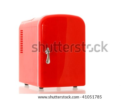 Shiny bright red miniature fridge - stock photo