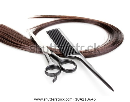 Shiny brown hair with hair cutting shears and comb isolated on white - stock photo