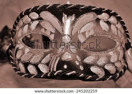 Shiny carnival mask on a light background - stock photo