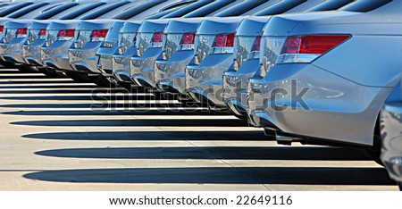 Shiny cars standing on parking lot - stock photo
