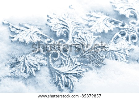 Shiny Christmas ornaments with snow. High key blue toned macro with extremely shallow dof. - stock photo