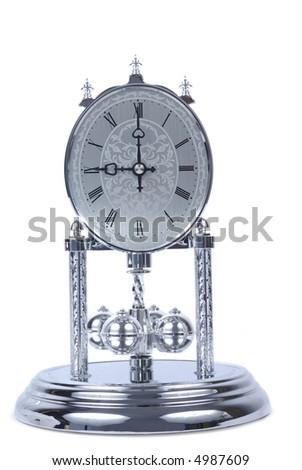 Shiny chrome clock isolated over white background - stock photo