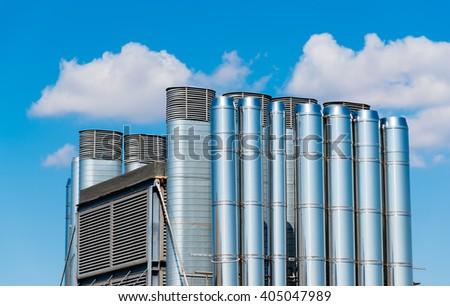 shiny chrome pipes against the blue sky - stock photo