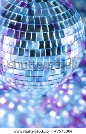 Shiny disco ball in blue light - stock photo