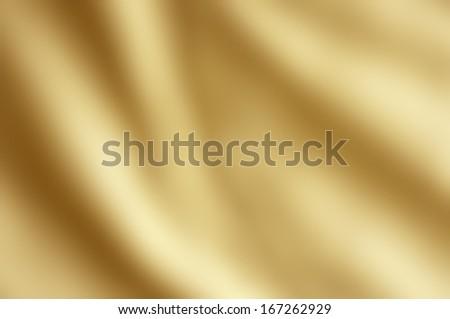 Shiny draping satin fabric in golden yellow hue. - stock photo
