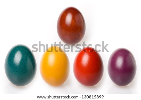 Shiny Easter eggs of different colors (Brown, Green, Yellow, Red and Purple) on white background - stock photo