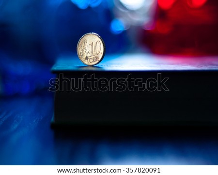 Shiny euro coin with french flag color on background