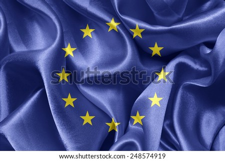 shiny fabric flags of the European Union - stock photo