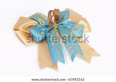 Shiny gold & blue ribbon bow on white background - stock photo