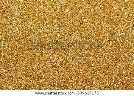 Shiny gold glitter texture background - stock photo