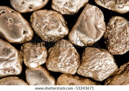 shiny gold nuggets background. closeup. - stock photo