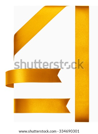 Shiny gold satin ribbon on white background - stock photo