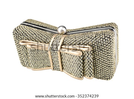 Shiny golden ladies purse. Isolated on white background.Clutch in the form of a bow. - stock photo