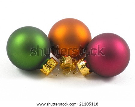 Shiny Green, Gold, and Purple Holiday Christmas Tree Ornaments Isolated on a White Background