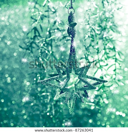 shiny green star. christmas decoration. abstract background. christmas or new year card concept - stock photo