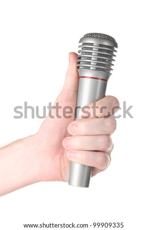 Shiny grey iron microphone in hand isolated on white