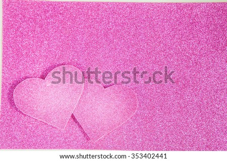 Shiny hearts on pink background. Valentine's day background - stock photo
