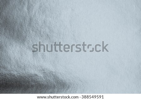 Shiny hot silver grey blue paper foil leaf decorative texture background: Bright brilliant festive glossy metallic look texture backdrop: Metal steel like material pattern surface design decoration  - stock photo