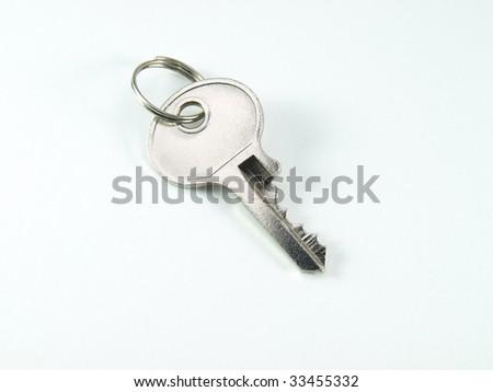 Shiny key isolated on white background - stock photo