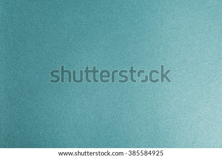 Shiny light cyan blue teal silver color decorative texture paper: Bright brilliant festive glossy metallic look textured empty backdrop: Aluminium tin metal material for craft design decoration - stock photo