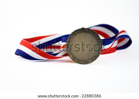 Shiny medallion with a red, white and blue ribbon - stock photo